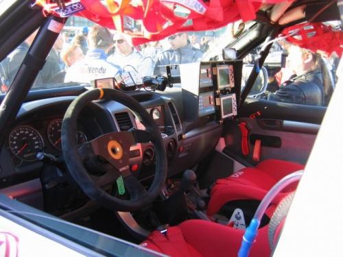 Тоже пробег. В кабине гоночного автомобиля. Хотя мне больше понравились наши КАМАЗы. Пилотсмеялся - в кабине не сидеть надо, надо здесь прокатиться