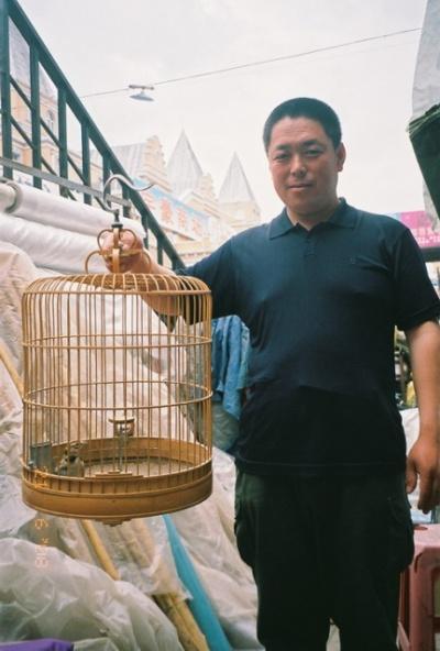 Торговец птицами.