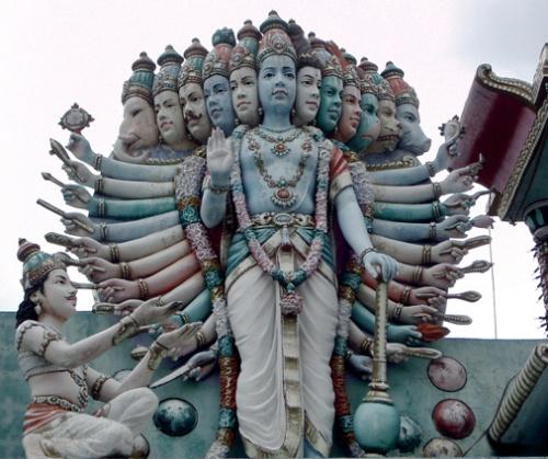Singapore. Statue of Krishna as Vishnu in his Vishwarupa (Universal form).