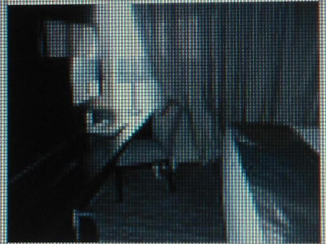 Туалетный столик, телевизор и напротив - кровать