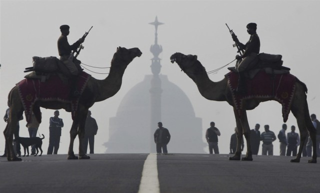 """Members of the Indian Border Security Forces mounted on camels, rehearse """"Beating the Retreat"""" as part of preparations for Republic Day celebrations a"""