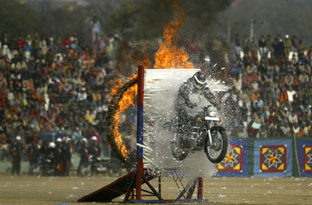 A Jammu and Kashmir state police daredevil performs stunts during the Republic Day celebrations in Jammu, India, Tuesday, Jan. 26. AP / Channi Anand