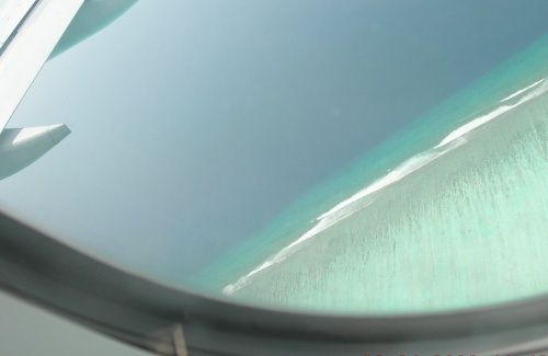 Из самолета...