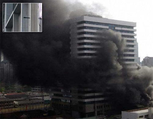 Smoke billows from CentralWorld at the Ratchaprasong intersection