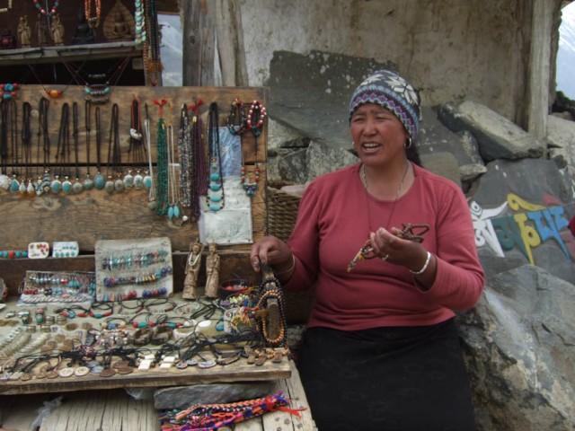У этой приятной и общительной бабушки купил амулетик из кости. Поддержал местного производителя.