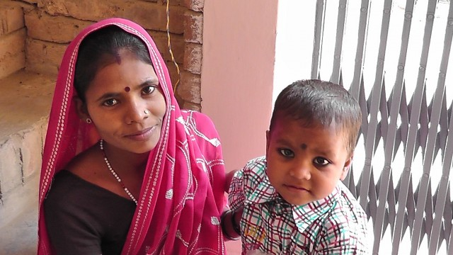 village boy with mom