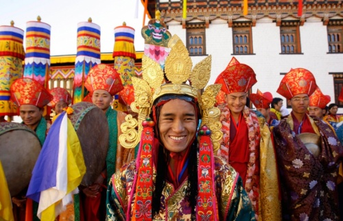 Traditionally attired Bhutanese dancers smile during the coronation ceremony
