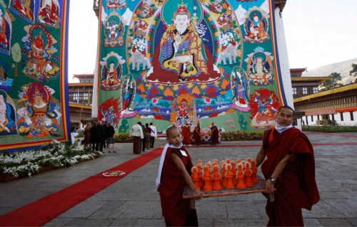Monks help with preparations during the coronation ceremony of Bhutan's fifth King