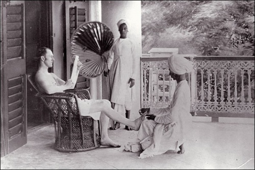 A British man gets a pedicure from an Indian servant