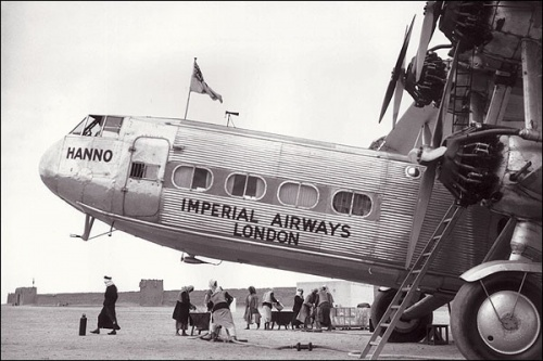 The Imperial Airways 'Hanno' Hadley Page passenger airplane carries the England to India air mail, stopping in Sharjah to refuel.