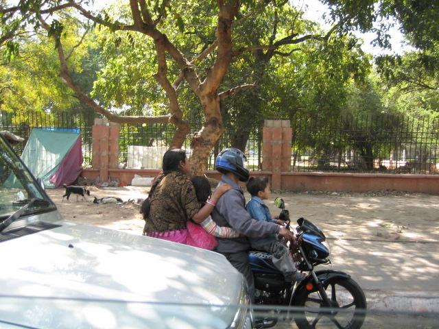У нас детей запрещено возить на переднем сиденье даже в машине, а там они ездят так на мотоцикле, и ничего - все живы-здоровы )))