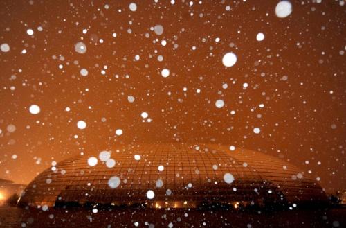 Снег летит над Великим национальным театром